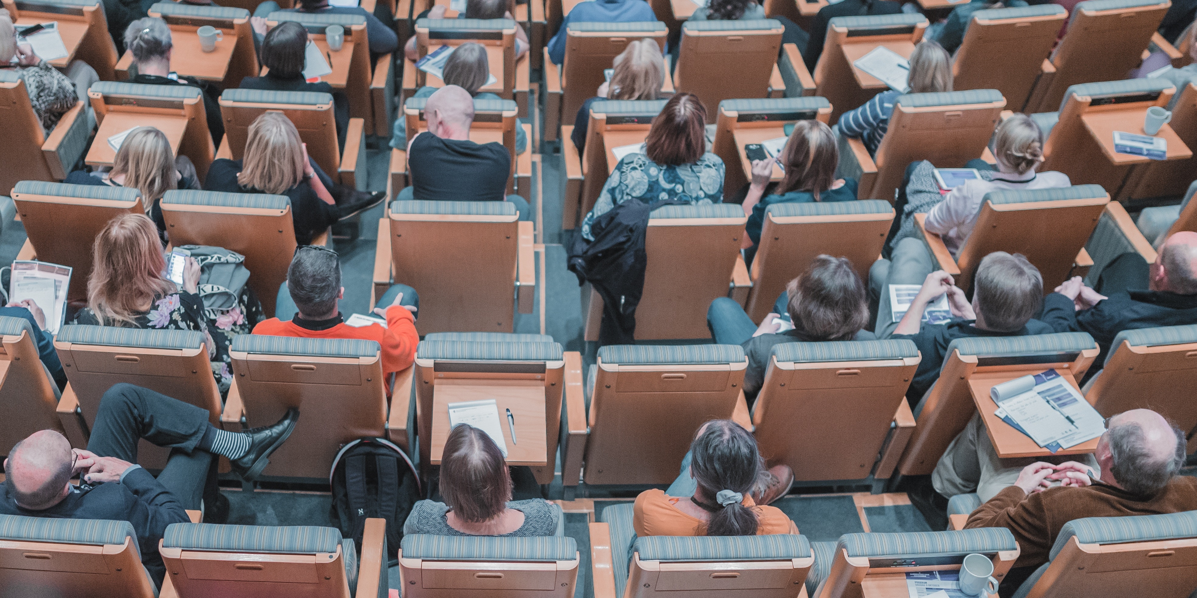 Group of professionals in lecture hall