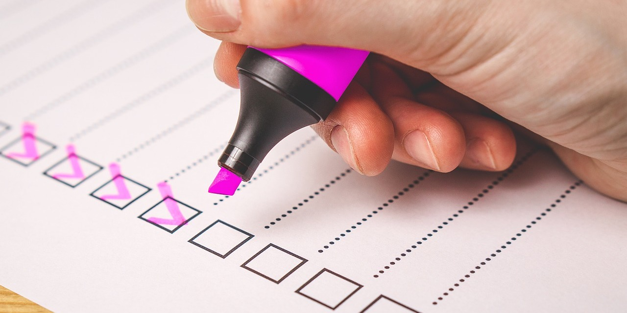 Checklist with boxes ticked with pink highlighter
