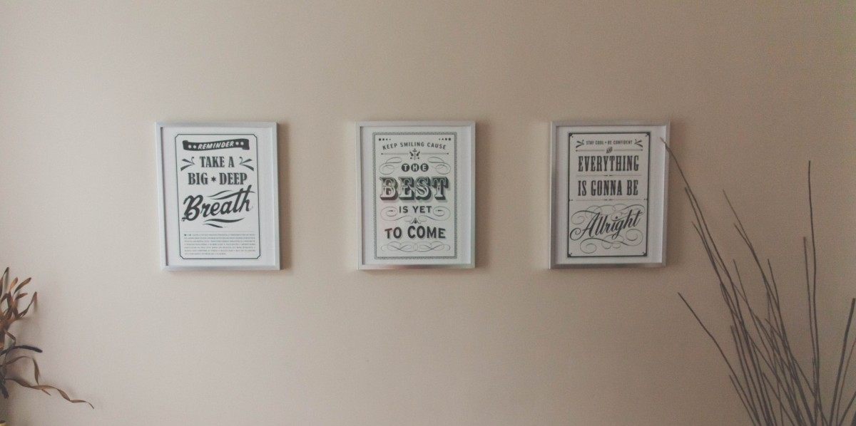 Inspirational phrases in frames on office wall