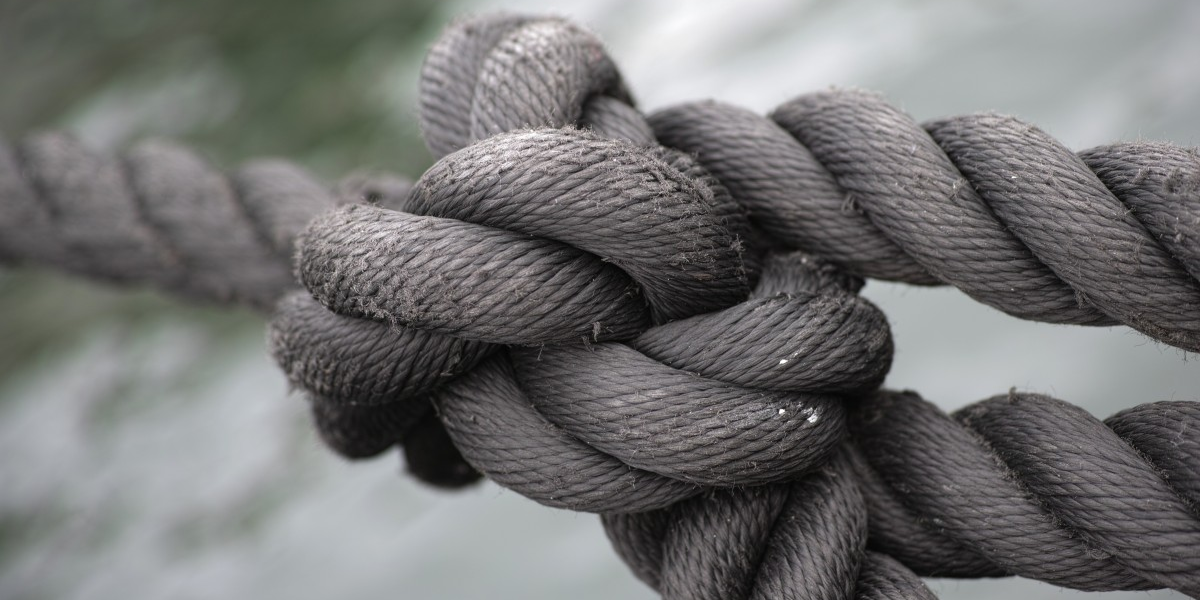Thick grey rope tied in tight knot