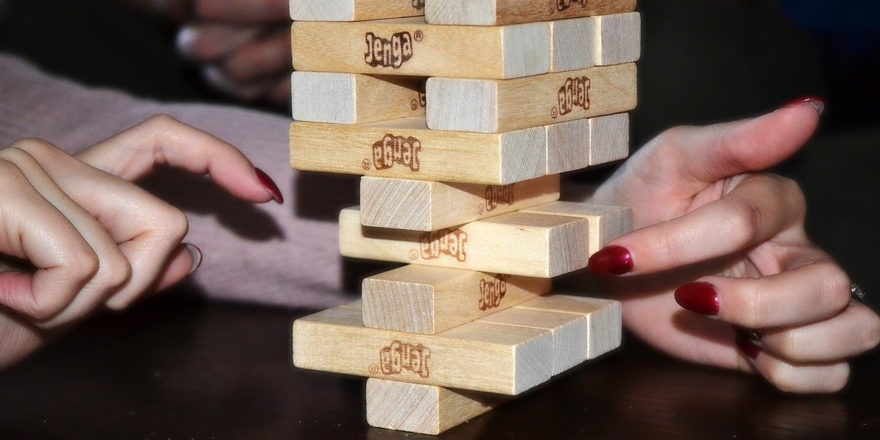 Jenga game close to falling