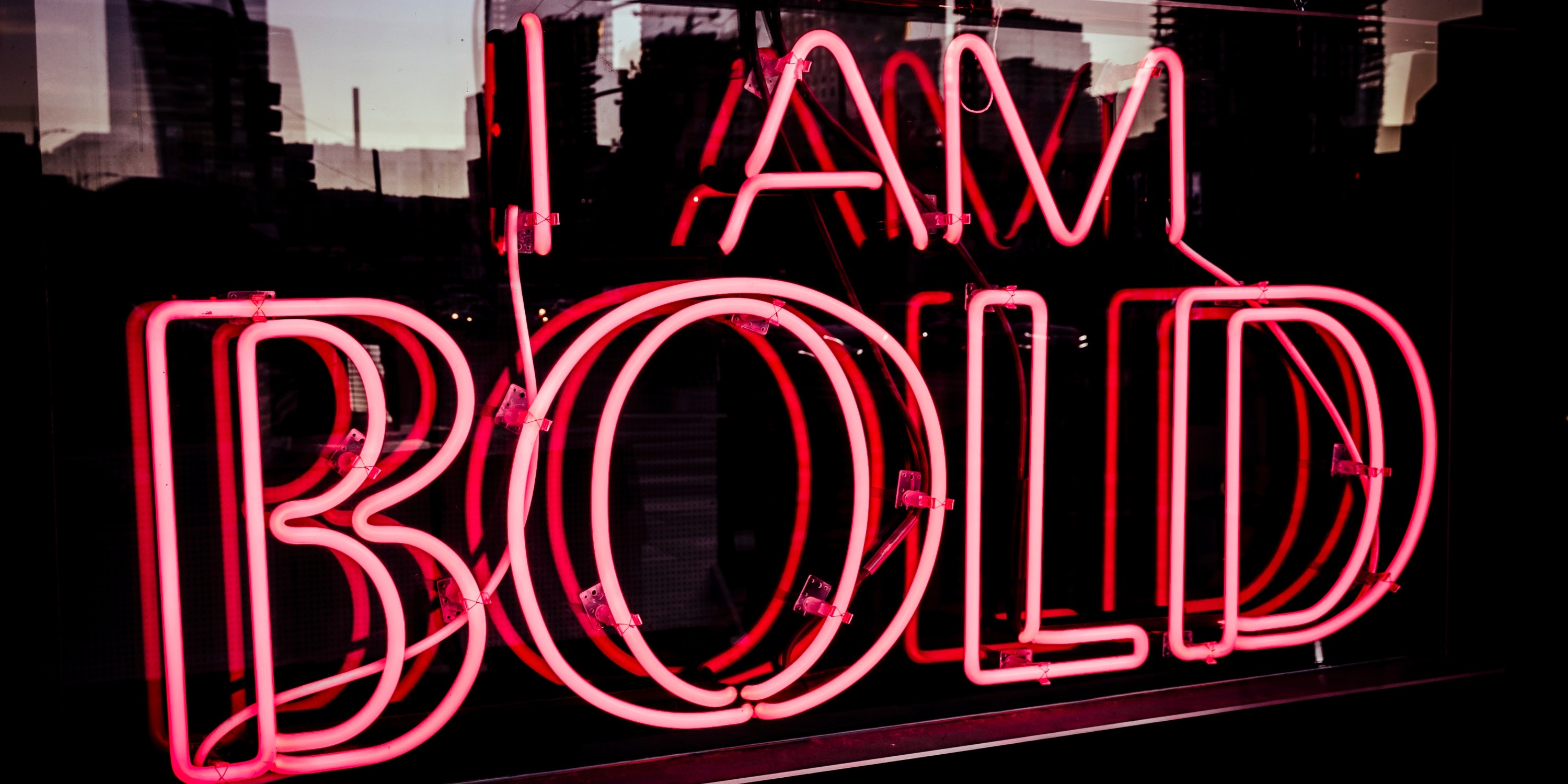 Neon sign saying I am bold