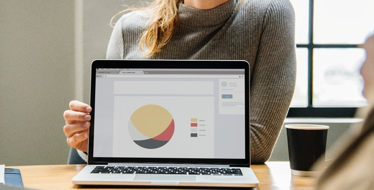 Woman presenting business results on laptop